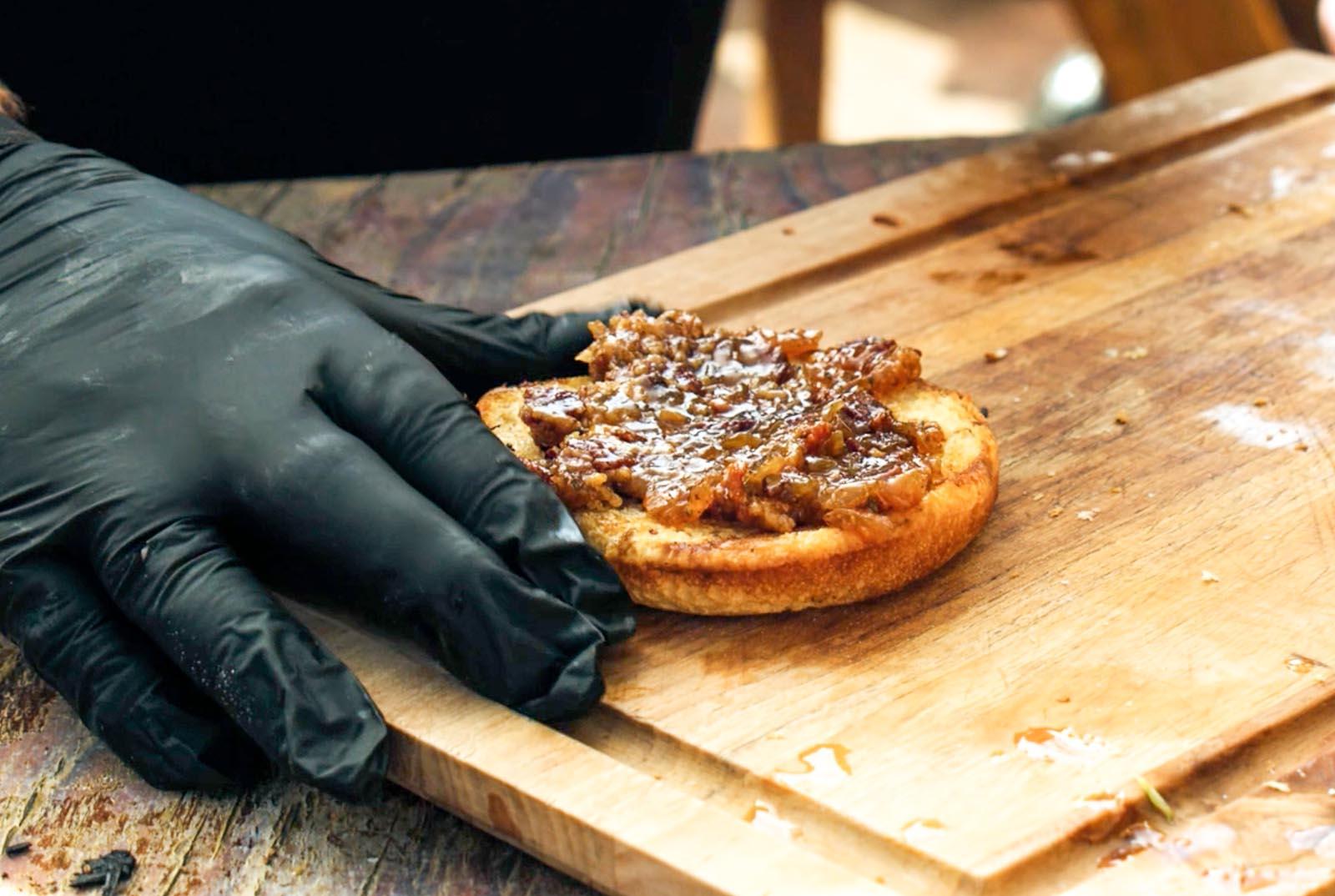 Bacon bourbon jam spread on a toasted hamburger bun