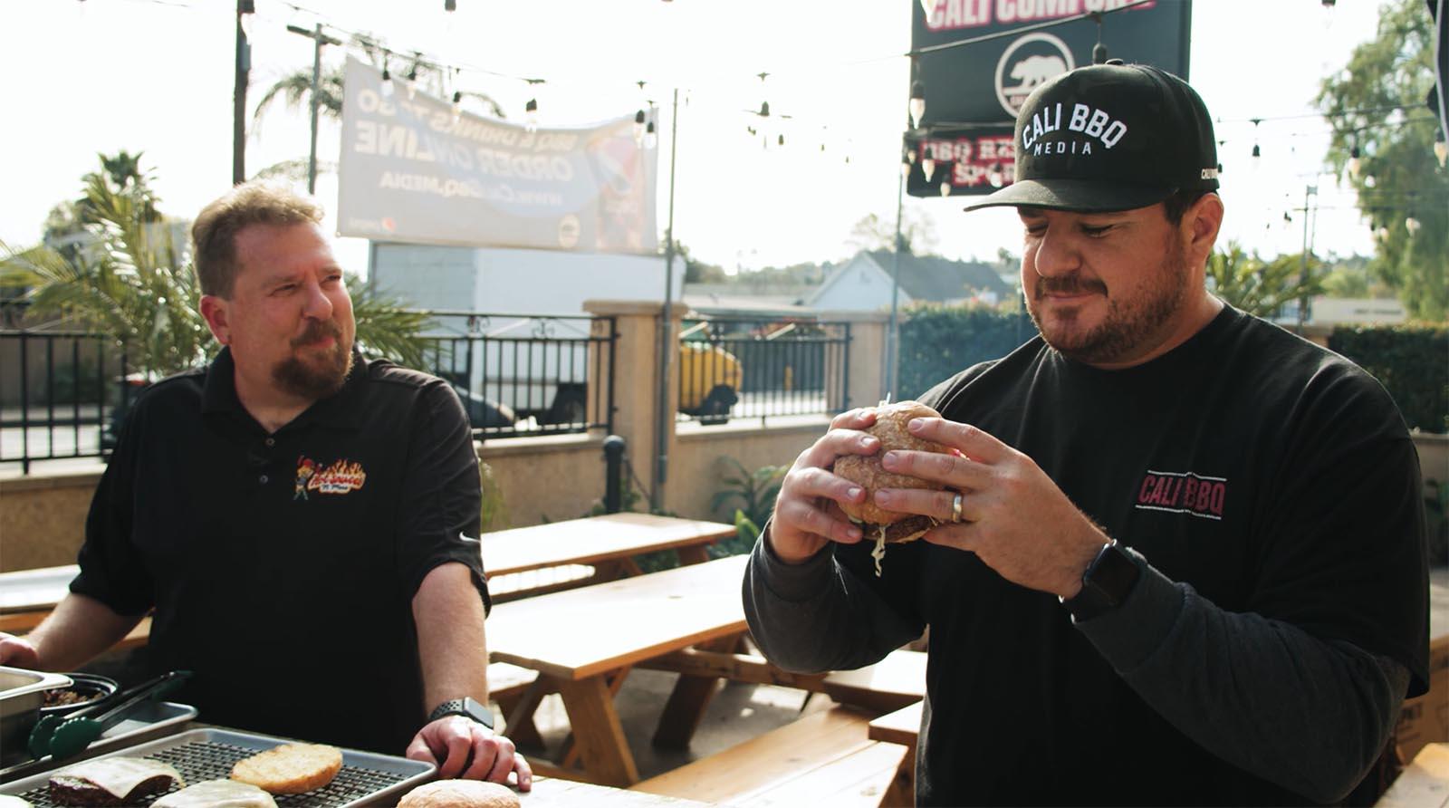 Shawn Walchef of Cali BBQ eats a burger