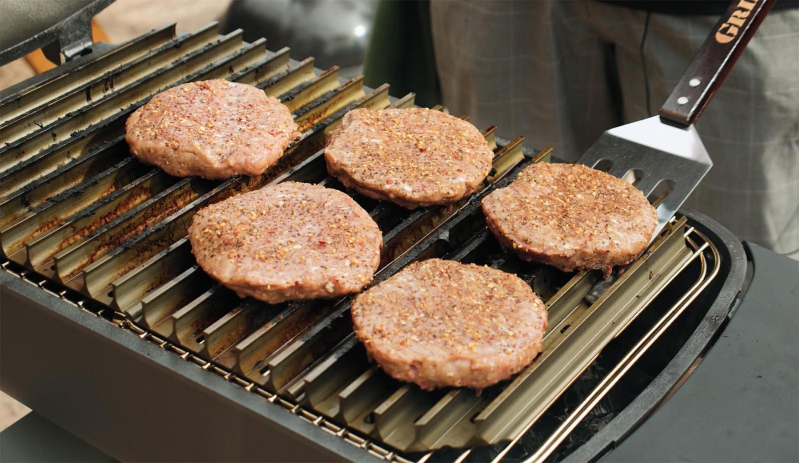 Seasoned wagyu burgers on a PK Grill
