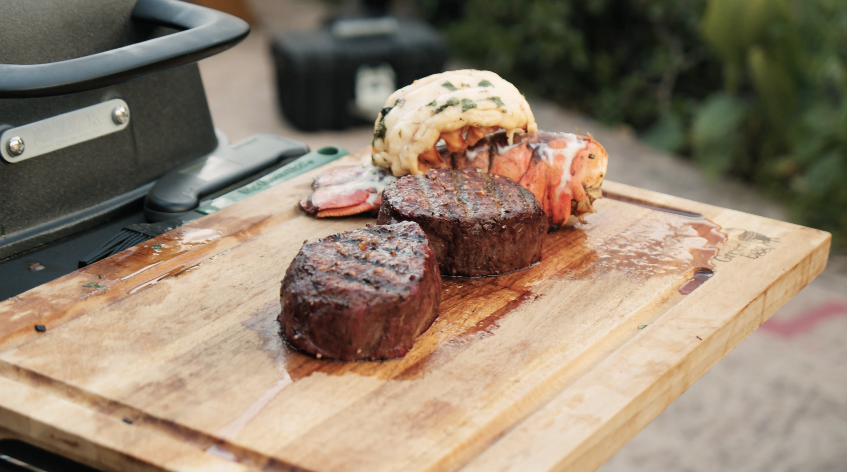 Filet Mignon with lobster tail on cutting board
