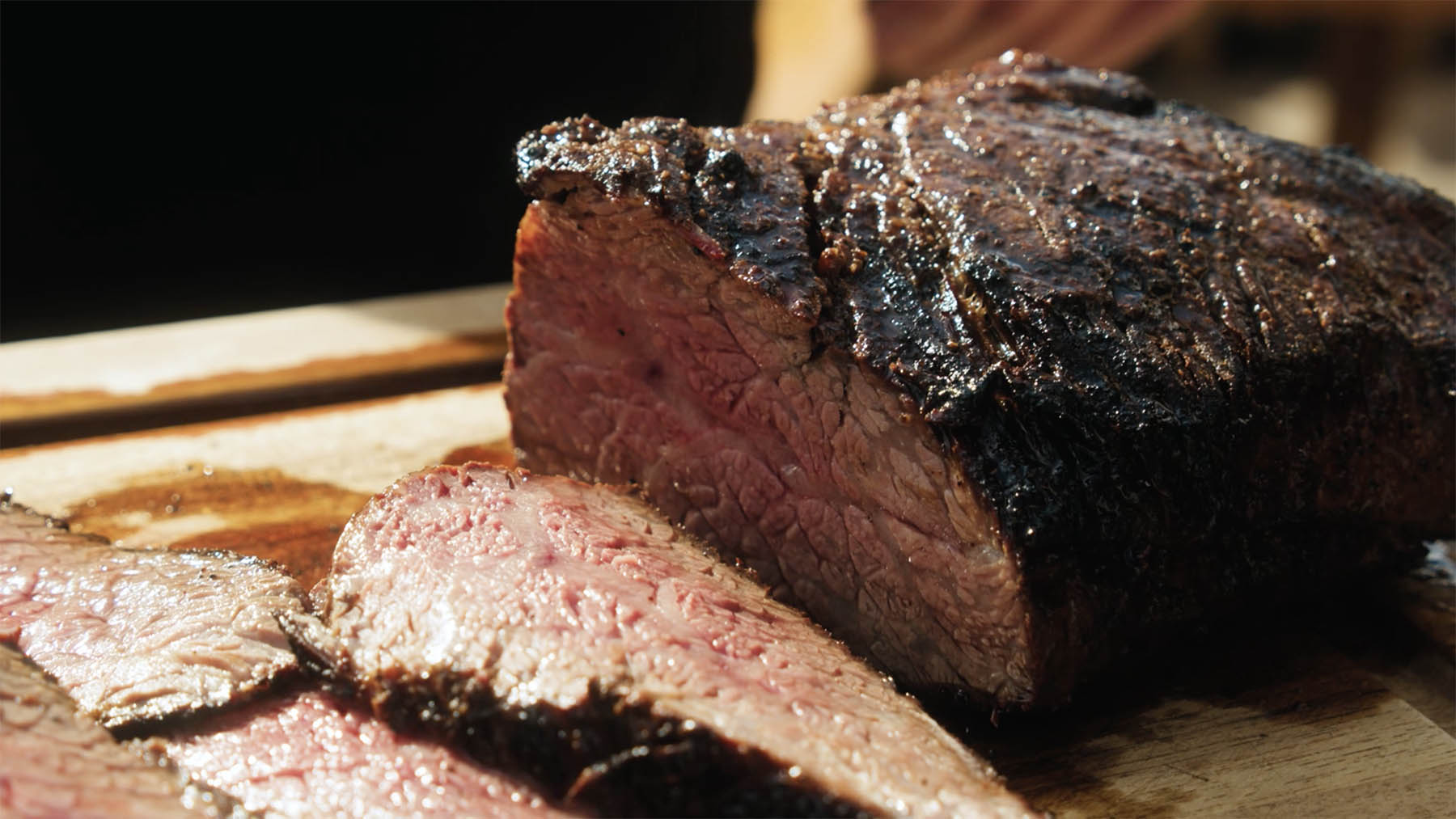 Perfectly cooked tri-tip being sliced cross-grain