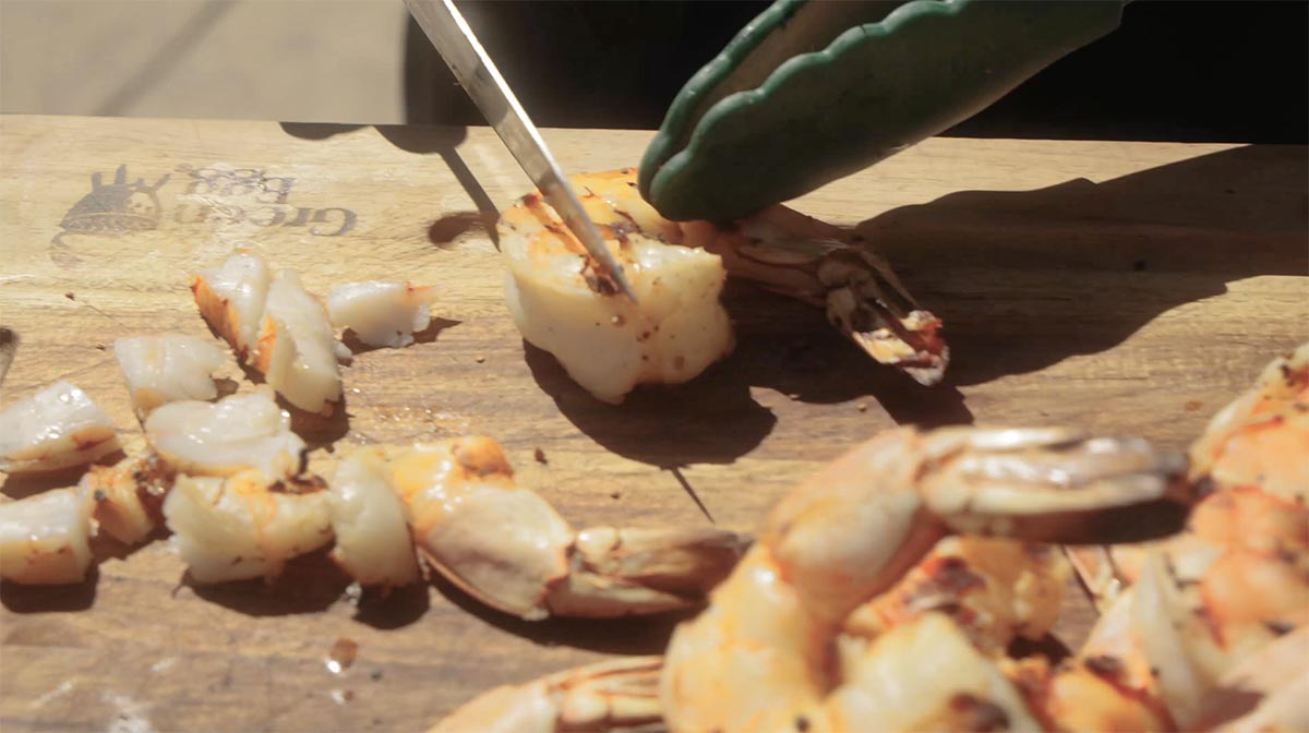 Grilled shrimp being chopped for ceviche