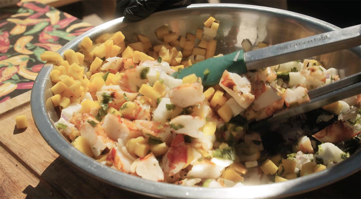 Grilled shrimp ceviche being mixed in a bowl